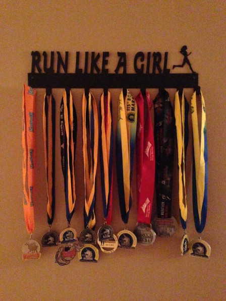 My Medal Display.  Its not custom - they sell one that says Run Like a Girl!