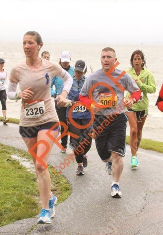 The race photos are among the worst ever taken of my in my running career but I look equally miserable, soaked and tough in this one.