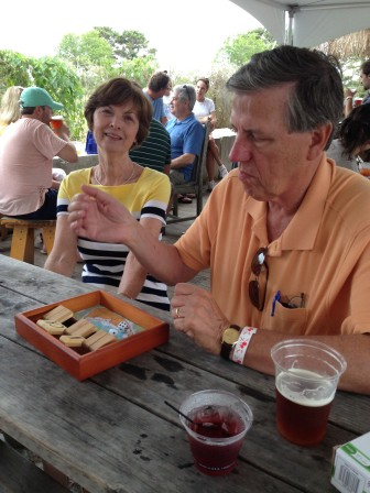 Dad's learning some strategy for Shut The Box at the brewery