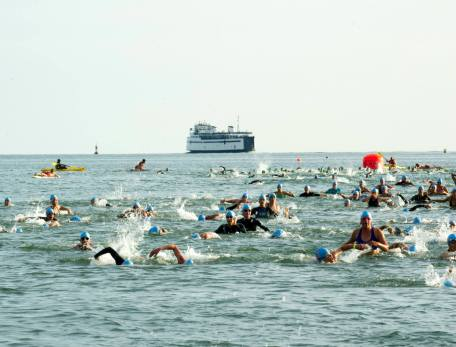 My age group working to finish up the swim